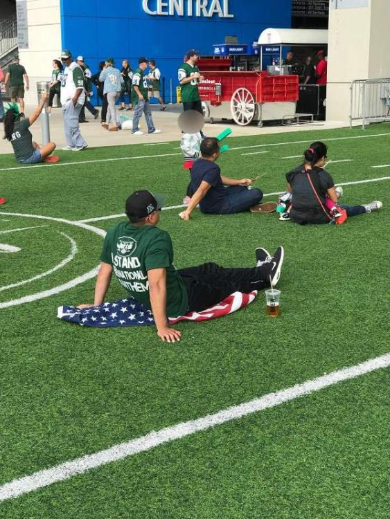 Deadspin-full-flag-sitting-guy_blur-1.jpg